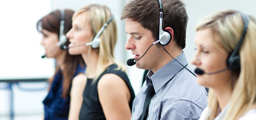 call centre operators, using microphone headsets