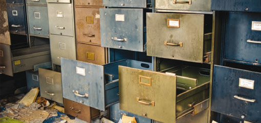 old filing cabinets with open, empty, drawers