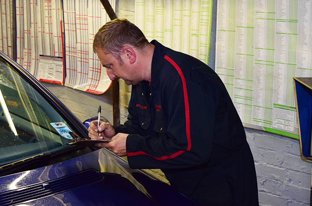 MOT Tester inspecting a vehicle
