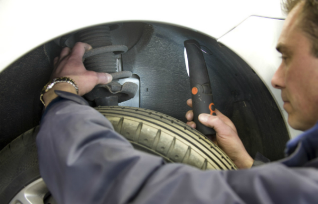 An MOT tester testing a wheel