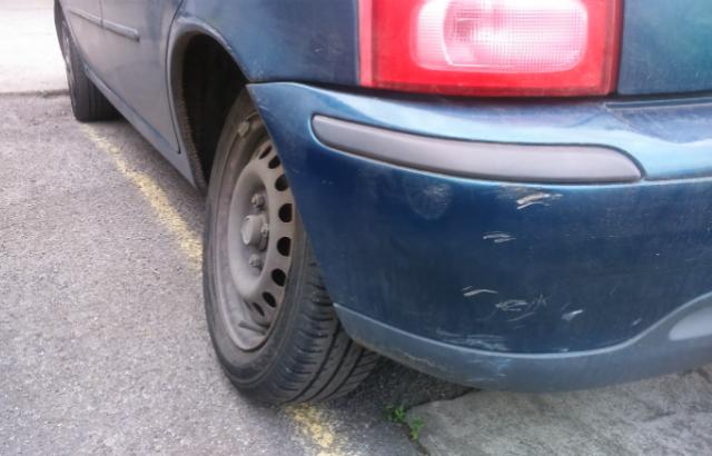 Badly corroded rear axle on car