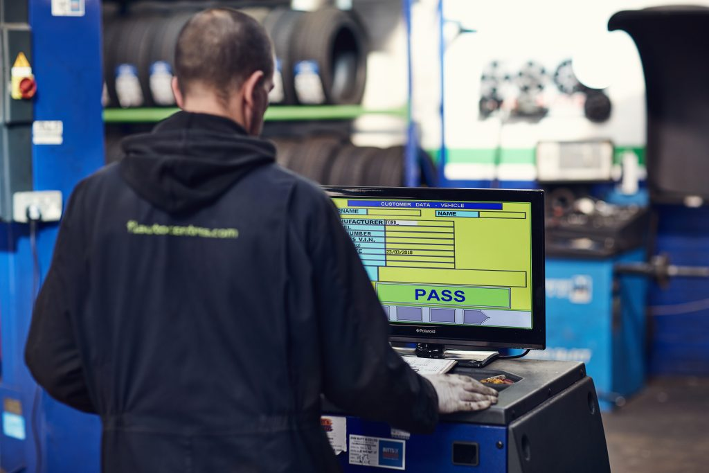 Man in front of MOT testing machine