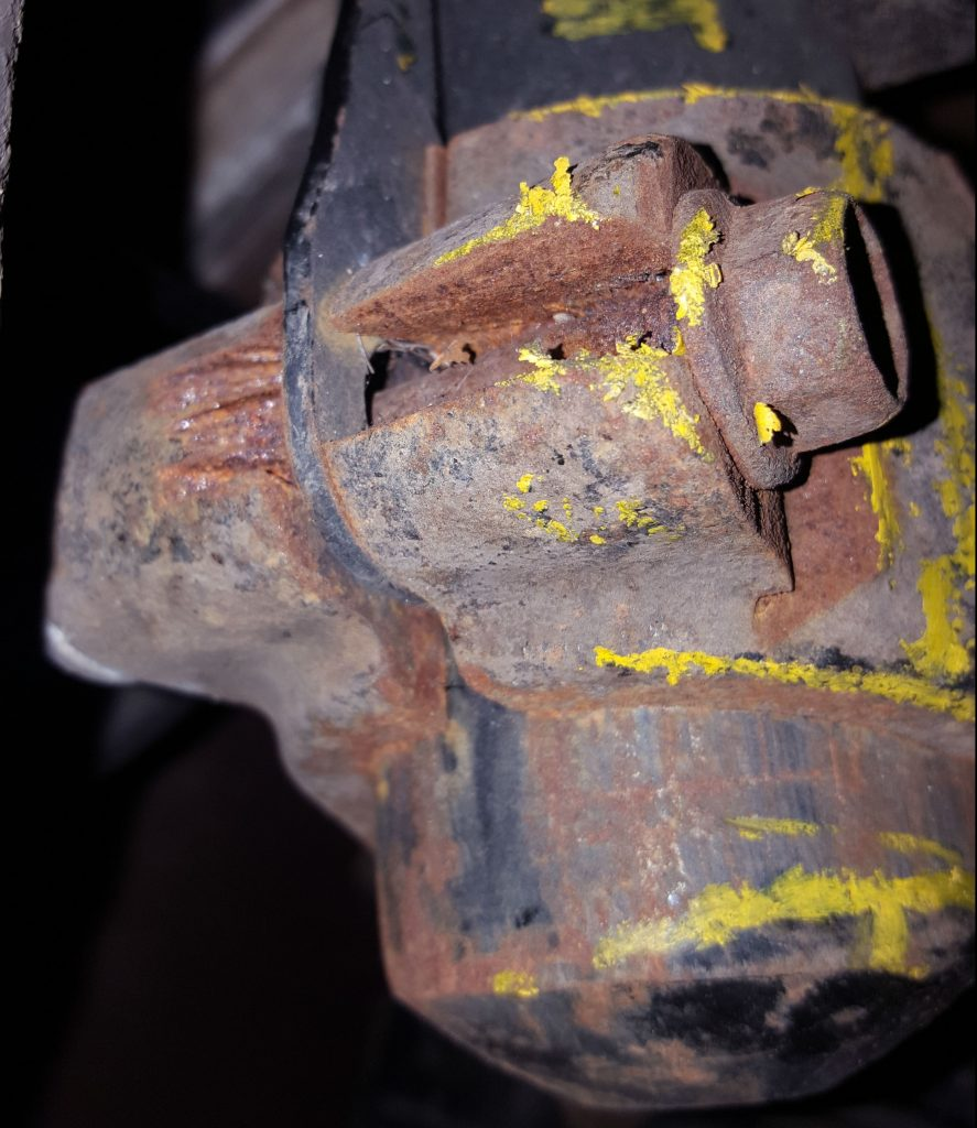 A badly corroded shock absorber