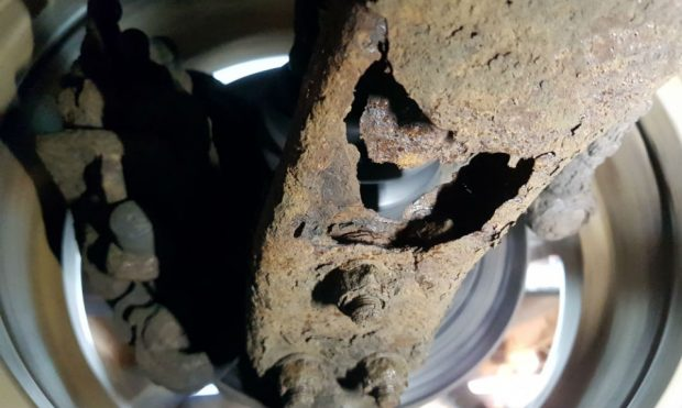Corroded suspension lower arm