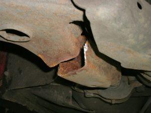 A badly cracked car wishbone