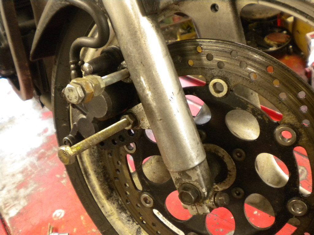 Bolts sticking out of motorcycle wheel