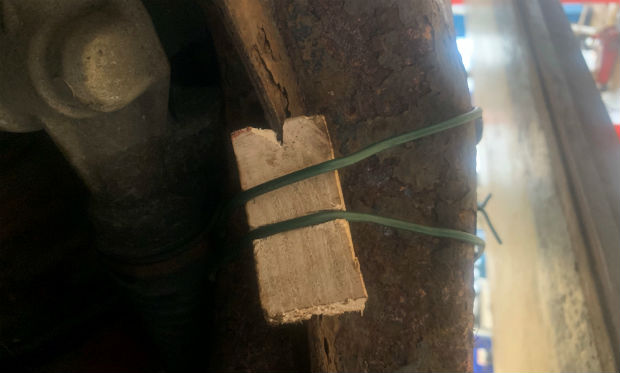 Wooden stake and cable repair to wheelarch